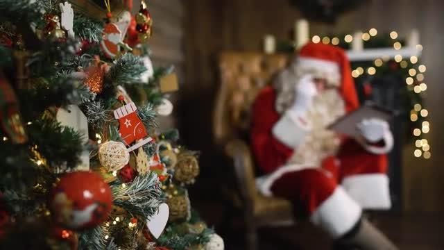 Santa Claus Using Digital Tablet: Stock Video