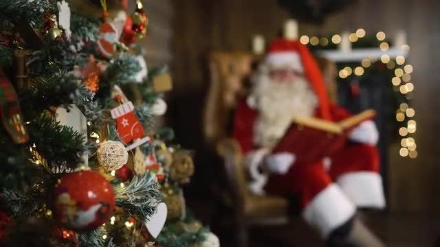 Santa Claus Looking At Book: Stock Video