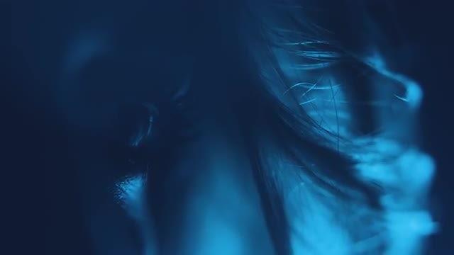 Woman Opening Eye In Dark: Stock Video
