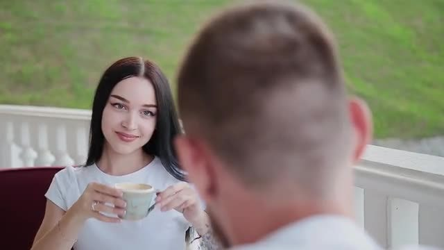 Couple Drinking Coffee In Cafe: Stock Video