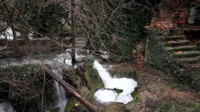 Small Creek Near Ruined House: Stock Video