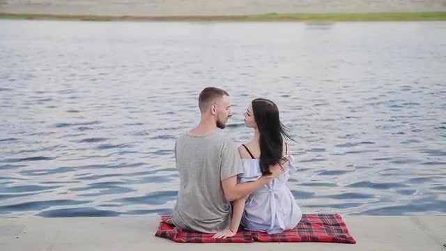 Lovers Sitting By The River: Stock Video