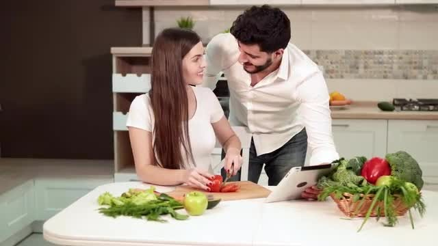 Couple Follows Recipe While Cooking: Stock Video