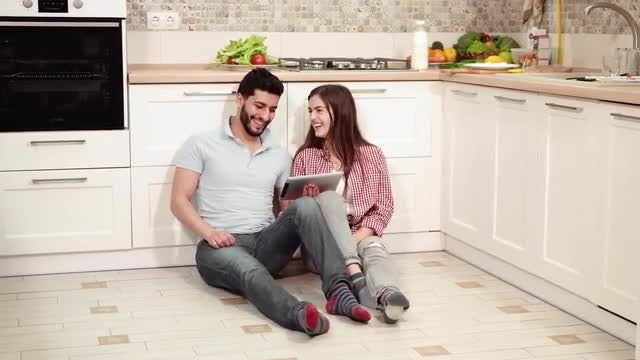 Happy Couple On Kitchen Floor: Stock Video