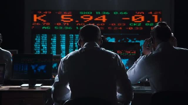 Traders Analyzing Data On Exchange: Stock Video