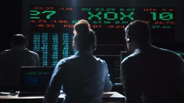 Stock Broker Working In Office: Stock Video