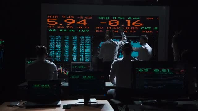 Stockbrokers Analyzing Live Feeds: Stock Video