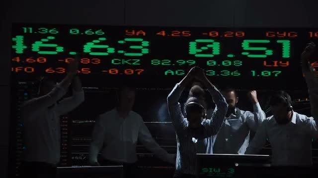 Stockbrokers Celebrating In Modern Office: Stock Video