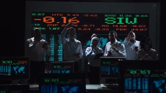 Zealous Stockbrokers Busy Working: Stock Video