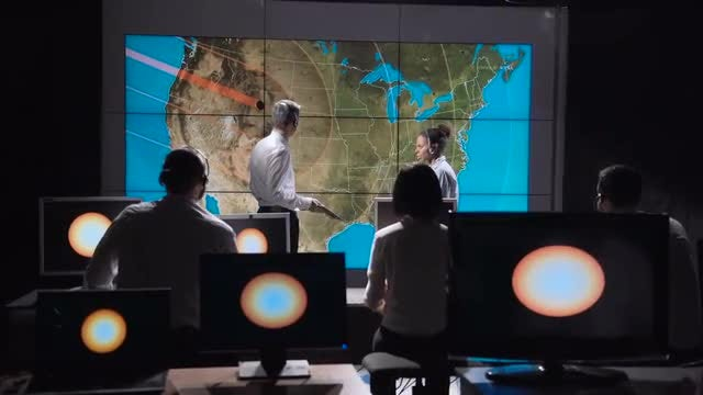 Scientists Discussing Solar Eclipse: Stock Video