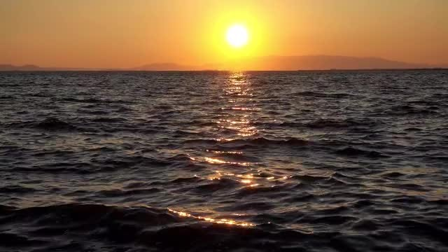 Yellow Sun Over Dark Ocean: Stock Video