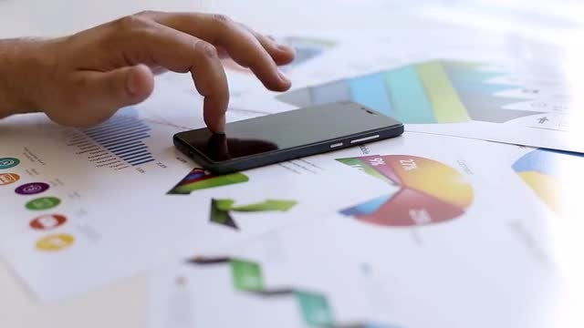 Businessman Tapping On A Smartphone: Stock Video