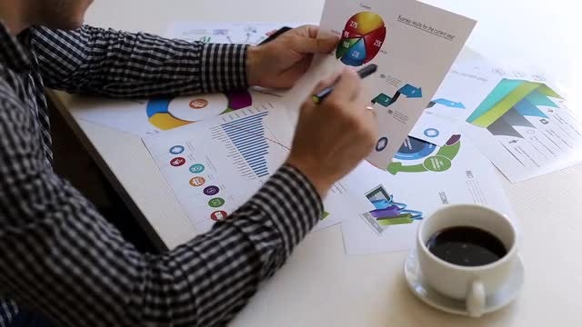 Businessman Analyzing Market Statistics: Stock Video