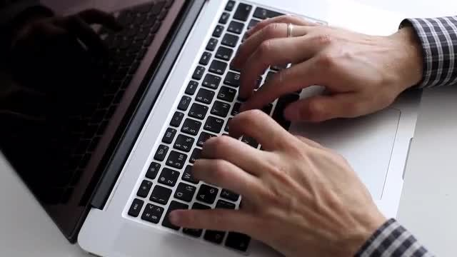 Man Typing On A Laptop: Stock Video