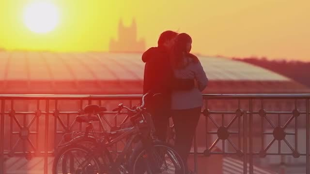 Sweet Couple Enjoying Scenic Sunset: Stock Video