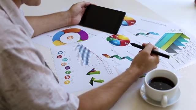 Businessman Analyzing Business Statistics: Stock Video