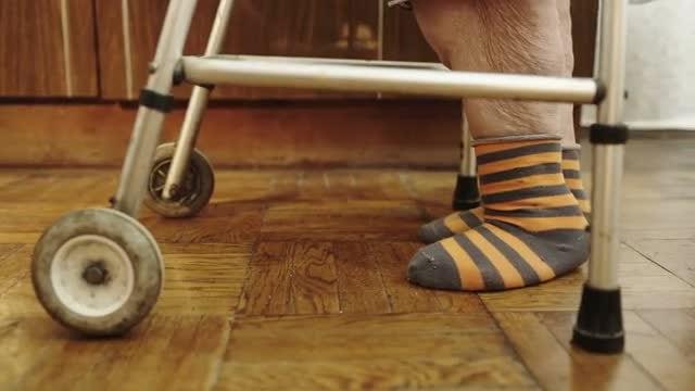 Senior Woman Walking With a Walker: Stock Video