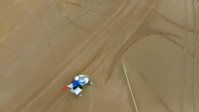 ATV Rider On Sand Dunes: Stock Video