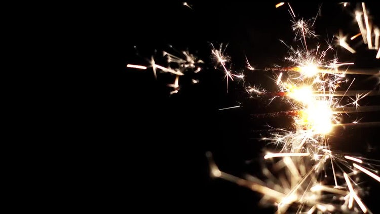 Horizontal Burning Sparklers: Stock Video