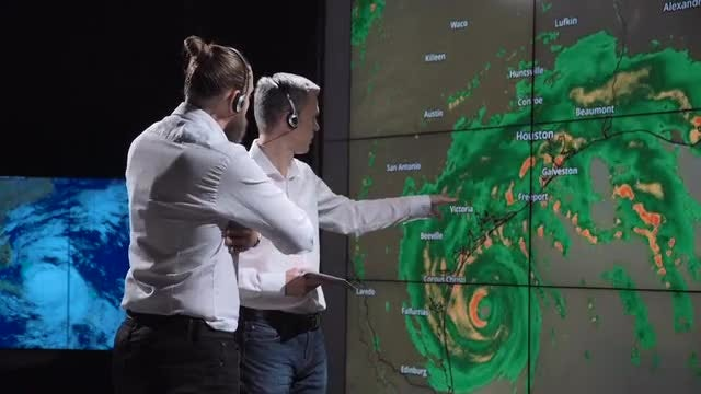 Scientists Tracking Hurricane On Screen: Stock Video