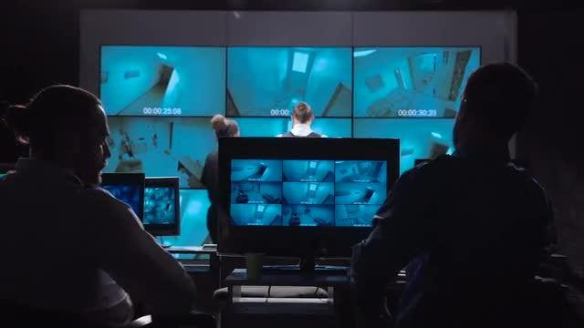 Officers Monitoring Surveillance Cameras: Stock Video