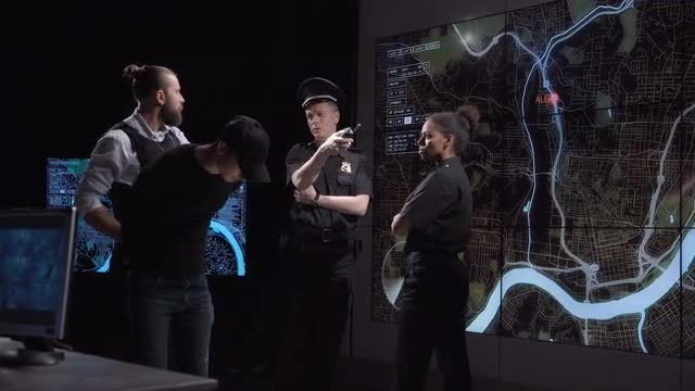 Police Officers Watching GPS Map: Stock Video