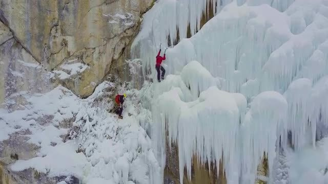 Two Men Climbing Frozen Waterfall: Stock Video