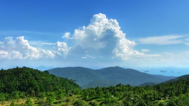 Puffy Clouds And Mountain Landscape: Stock Video