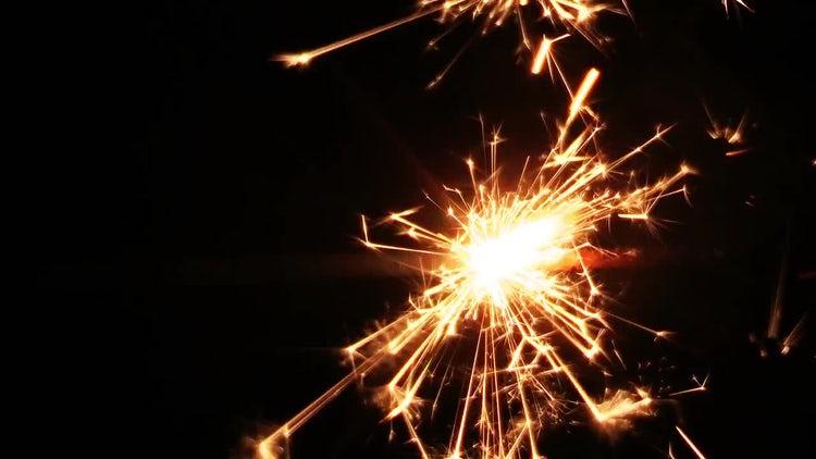 Sparkler Flame Against Black Background: Stock Video