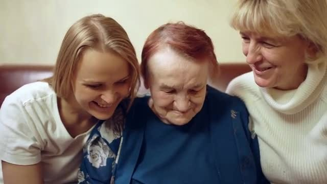 Three Generations Look Through Photos: Stock Video