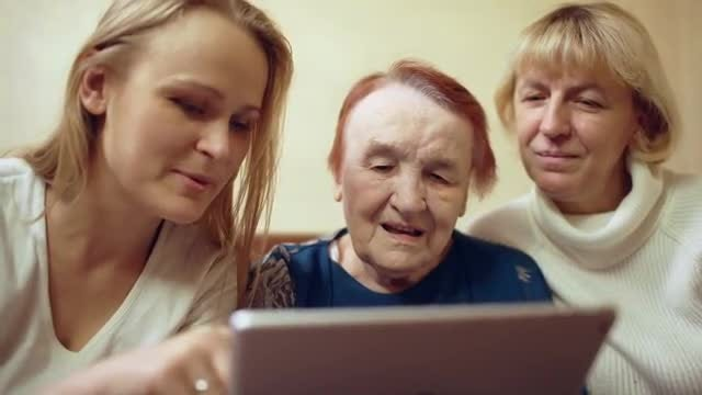 Women Using A Digital Tablet: Stock Video