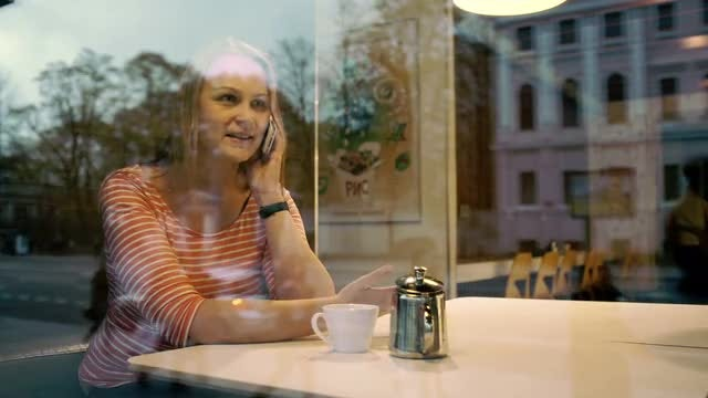 Woman Talking On Phone: Stock Video