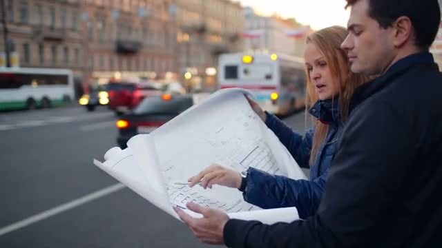 Discussing Architectural Plans Outdoors: Stock Video