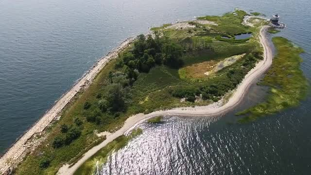 Aerial Shot Of Small Island: Stock Video