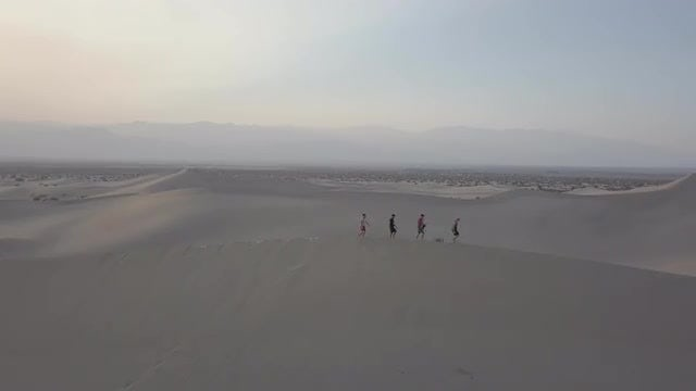 Four People Passing Death Valley: Stock Video