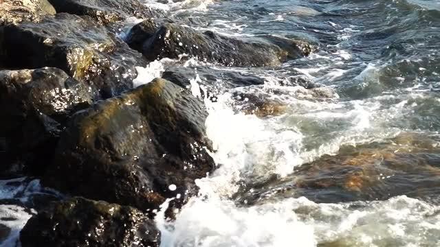 Ocean Waves Crashing Into Rocks: Stock Video