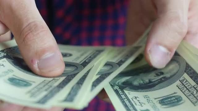 Man Counting New Dollar Bills: Stock Video