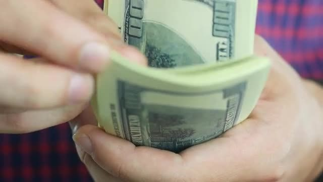 Man Counting Hundred-Dollar Bills: Stock Video