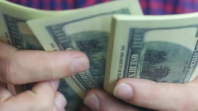 Man Shuffling Hundred-Dollar Bills: Stock Video