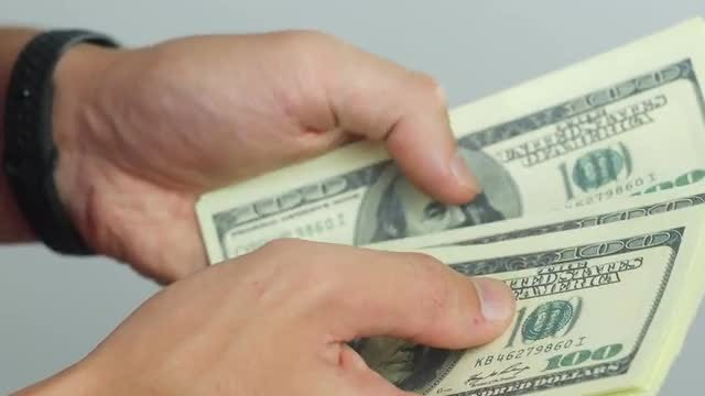 Counting Out Money: Stock Video