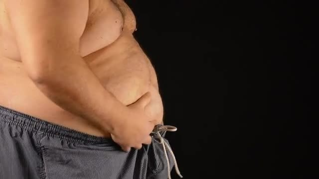 Fat Man Checks His Big Tummy: Stock Video