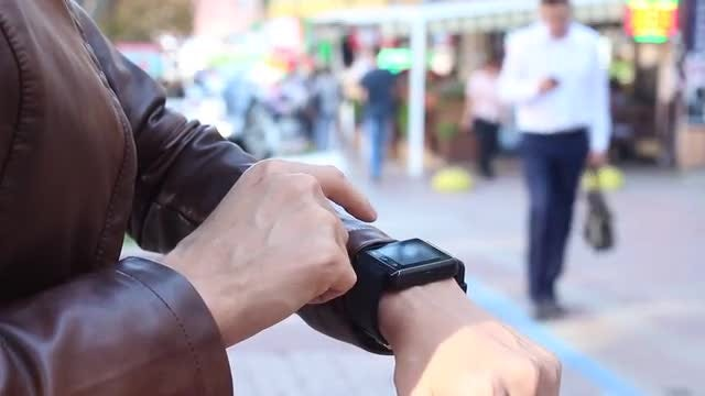 Checking Smart Watch Messages Outdoors: Stock Video