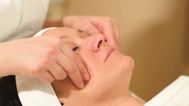 Woman Enjoying Facial Massage: Stock Video