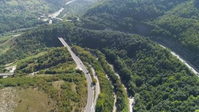 Trailing Vehicles Through The Mountain: Stock Video