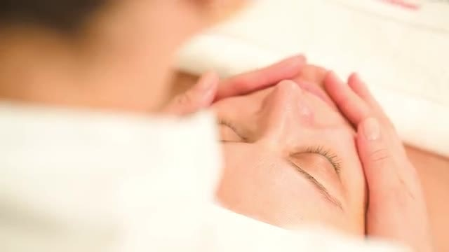 Masseuse Offering Facial Massage Therapy: Stock Video