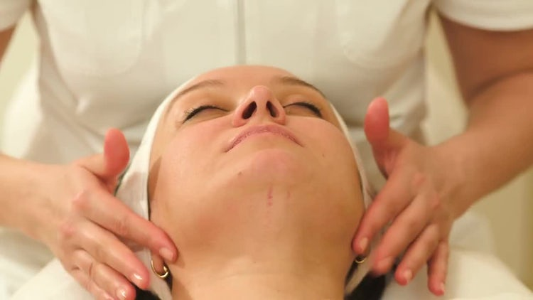 Woman Receiving Facial Massage: Stock Video