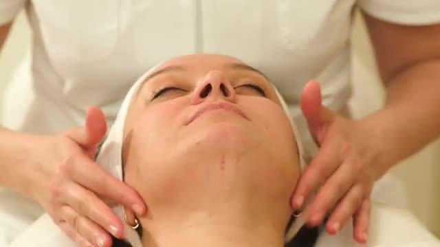 Woman Receiving Facial Massage: Stock Video