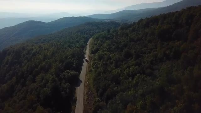 Truck Driving On A Mountain Road Aerial: Stock Video