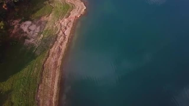 Aerial View Of A Ocean And Coast: Stock Video
