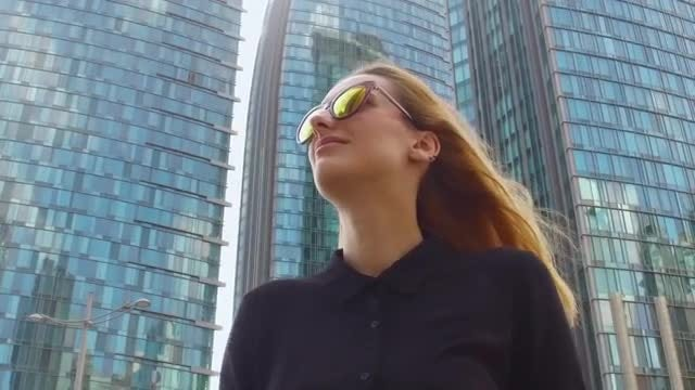 Woman Walking By Modern Building: Stock Video